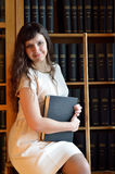 A young woman in the library Stock Image