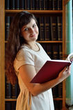 A young woman in the library Royalty Free Stock Images