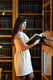 A young woman in the library Royalty Free Stock Image