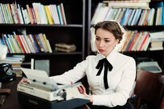 A young woman in the library Stock Photo