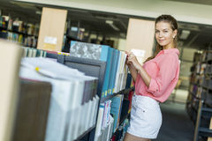 Young woman in the library Royalty Free Stock Photos
