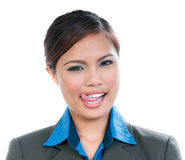 Young Woman Licking Lips. Portrait of a cute young Asian businesswoman licking lips over white background Royalty Free Stock Image