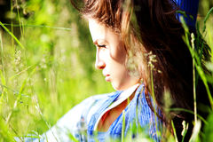 Young woman lie in grass Royalty Free Stock Images
