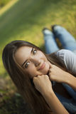 Young woman lie on grass in park Stock Photos