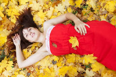 Young woman lies in  autumn park Royalty Free Stock Photos