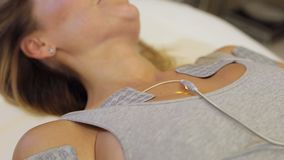 Skin Care concept. Woman getting electro stimulation therapy to her body.
