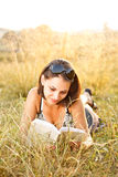 Young woman lies on grass Stock Photos