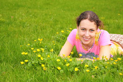 Young woman lies on grass Royalty Free Stock Photos