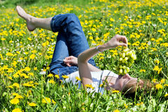 Young woman lies on a meadow Stock Photo