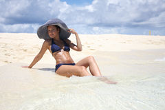 Young woman lies on the seashore Royalty Free Stock Image