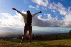 Young woman lifestyle. Young Women cheerfully looking over the island of Maui, Hawaii stock photo