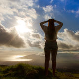 Young woman lifestyle. Young Women cheerfully looking over the island of Maui, Hawaii royalty free stock photo