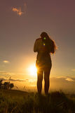 Young woman lifestyle. Beautiful young woman looking out over Hawaiian sunset stock image