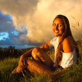 Young woman lifestyle. Young Women cheerfully looking over the island of Maui, Hawaii royalty free stock photos