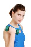 Young woman lifting dumbbell Stock Photography