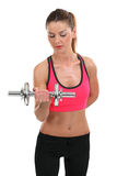 Young woman lifting a dumbbell Royalty Free Stock Photography