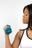 Young Woman Lifting Dumbbell Stock Image