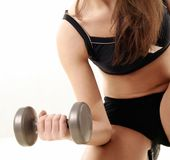 Young woman lifting dumbbell. Stock Photography