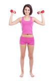 Young woman lifting dumbbells Stock Image
