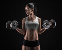 Young woman lifting the dumbbells Stock Photography