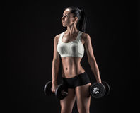 Young woman lifting the dumbbells Royalty Free Stock Photo