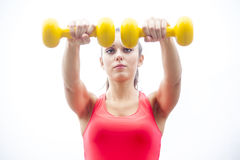 Young woman lifting dumbbells Stock Photos