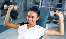 Young woman lifting free weights Stock Photo