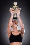 Young Woman Lifting Trophy Royalty Free Stock Image