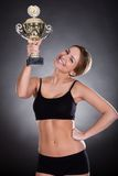 Young Woman Lifting Trophy. A Young Female Player Raising Her Trophy stock photography
