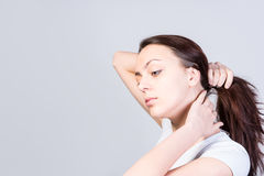 Young woman lifting up her hair Stock Photography