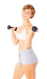 Young Woman Lifting Weights Stock Photo