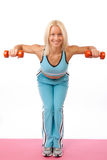Young woman lifting weights Stock Photography