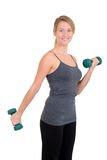 Young woman lifting weights Royalty Free Stock Photos
