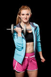 Young Woman Lifting Weights Stock Image