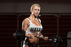 Young Woman Lifting Weights With Barbell Royalty Free Stock Image