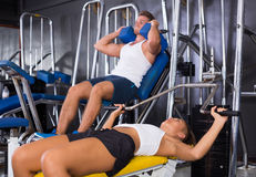 Young woman lifting weights in gym Royalty Free Stock Images