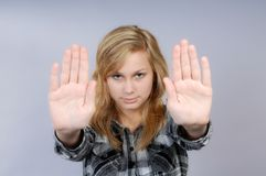 Young woman lifts hands in defense Stock Photo