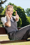 Young woman lifts thumb upwards Stock Photo