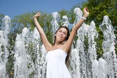 Young woman lifts upwards hands Royalty Free Stock Photography