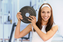 Young woman lifts weight Stock Photos