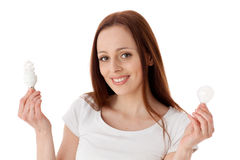 Young woman with lightbulbs. Stock Photography