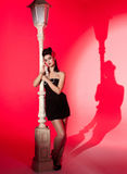 Young woman and lightpole Royalty Free Stock Photo