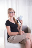Young woman likes receiving Euros.  Royalty Free Stock Photography
