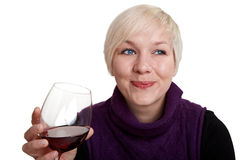 Young woman likes red wine Royalty Free Stock Photos