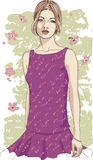 Young woman in a lilac dress Royalty Free Stock Photos