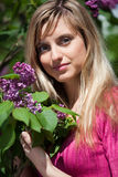 Young woman with lilac flowers Royalty Free Stock Images