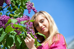 Young woman with lilac flowers Stock Photo