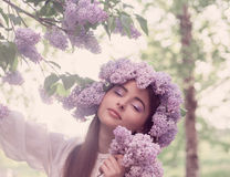 Young woman with lilac Stock Images