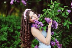 Young woman in lilac flowers Royalty Free Stock Image