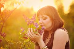 Young woman in lilac flowers Royalty Free Stock Photo